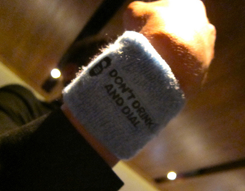 "photo of armband reading ""Don't Drink and Dial"""