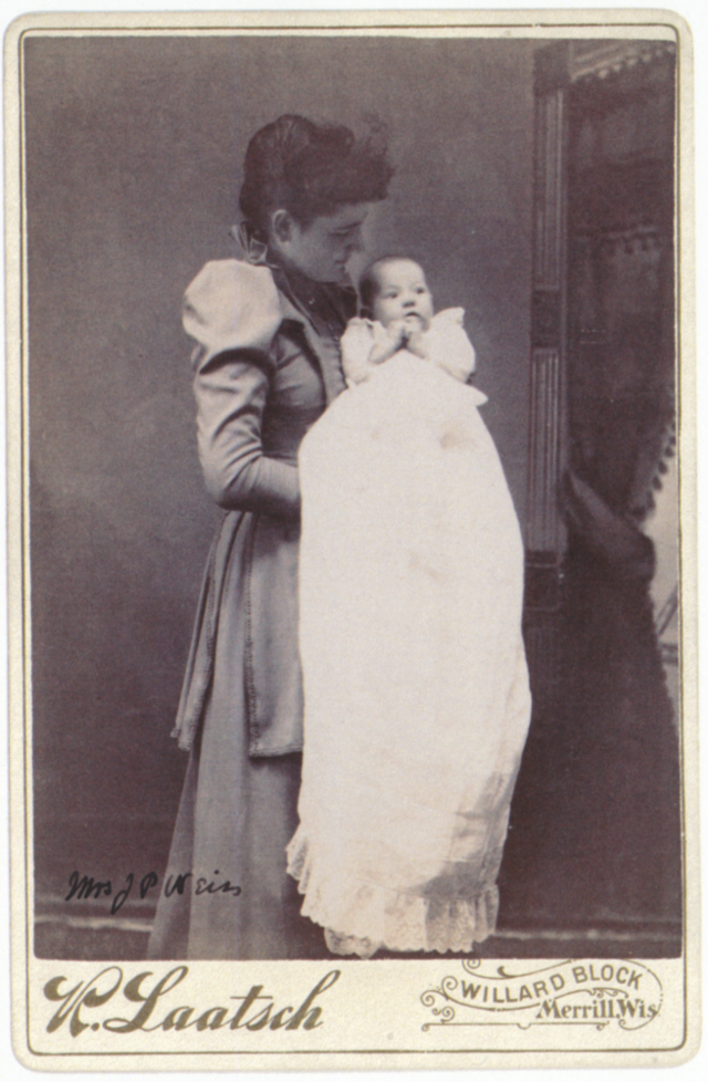 Frances Weiss holding a child
