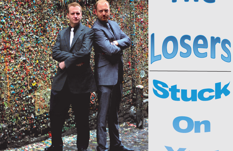 Album Cover of Stuck On You by The Losers, showing two men standing by Seattle's Gum Wall