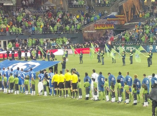 Seattle Sounders and Montreal Impact line up for the national anthem
